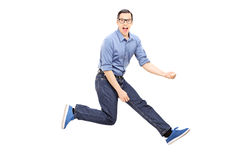 Young man doing an air guitar jump Stock Photos