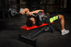Young man doing arms bench french press workout Stock Image