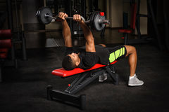 Young man doing arms bench french press workout Royalty Free Stock Photos