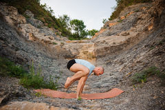 Young man doing an ashtavakrasana. Hand standing Royalty Free Stock Images