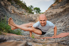 Young man doing an ashtavakrasana. Hand standing Royalty Free Stock Image