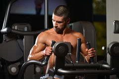 Young Man Doing Back Exercise On A Machine Stock Photo
