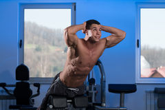 Young Man Doing Back Exercises In The Gym Stock Photo