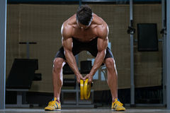 Young Man Doing Back Exercises In The Gym Royalty Free Stock Photos