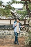 Young man doing a backpacking trip in a Korean traditional house. A young man doing a backpacking trip in a Korean traditional house royalty free stock image