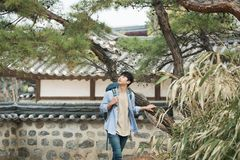 Young man doing a backpacking trip in a Korean traditional house. A young man doing a backpacking trip in a Korean traditional house royalty free stock images