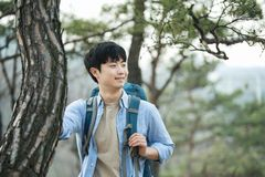 Young man doing a backpacking trip in a Korean traditional house. A young man doing a backpacking trip in a Korean traditional house royalty free stock photos