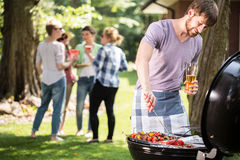 Young Man Doing Barbecue Royalty Free Stock Photos