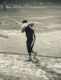 Young man is doing batting practice in a field. A young batsman is doing batting practice in a cricket ground unique photo royalty free stock photography