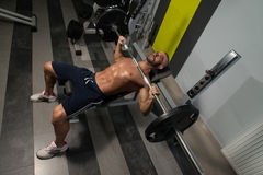 Young Man Doing Bench Press Exercise For Chest Royalty Free Stock Photos