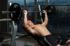 Young Man Doing Bench Press Exercise For Chest Stock Photos