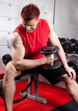 Young man doing bicep excercise Royalty Free Stock Image