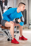 Young man  doing bodybuilding exercise Stock Images