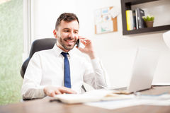 Young man doing business over the phone Stock Image