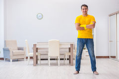 The young man doing chores at home. Young man doing chores at home Royalty Free Stock Photos