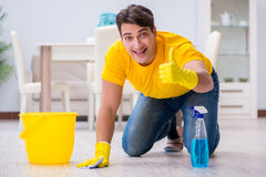 The young man doing chores at home Stock Photography