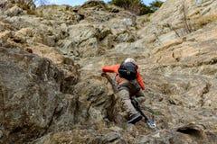 Men doing a climbing line in Canillo, Andorra. Young man doing a climbing line in Canillo, Andorra royalty free stock photos