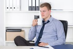 Young man is doing a coffee break Royalty Free Stock Photo