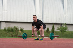 Young Man Doing A Deadlift Exercise Outdoor Stock Images