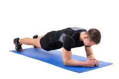 Young man doing Elbow Plank Workout Stock Images