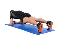 Young man doing Elbow Plank Workout Stock Photography