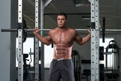 Young Man Doing Exercise Barbell Squat Royalty Free Stock Photo