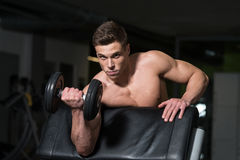 Young Man Doing Exercise For Biceps Stock Photo