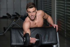 Young Man Doing Exercise For Biceps Royalty Free Stock Images