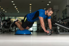 Young Man Doing Exercise On Bosu Balance Ball Royalty Free Stock Photo