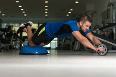 Young Man Doing Exercise On Bosu Balance Ball Royalty Free Stock Photography