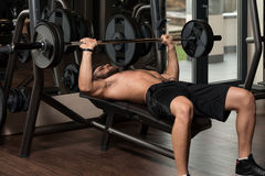 Young Man Doing Exercise For Chest With Barbell Stock Photos