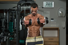 Young Man Doing Exercise For Chest Royalty Free Stock Image