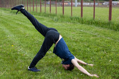 Young man doing an exercise in the city park Royalty Free Stock Photography