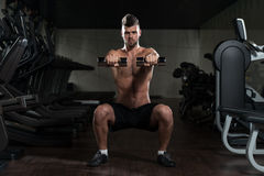 Young Man Doing Exercise Dumbbell Squat Stock Image