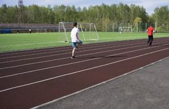 Young man in doing exercise. at the stadium stock photos