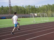 Young man in doing exercise. at the stadium royalty free stock photos
