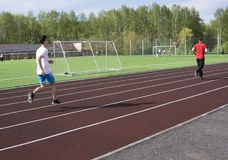 Young man in doing exercise. at the stadium stock image