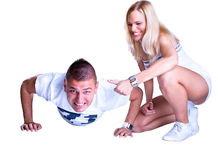 Young man doing exercise while woman counting Stock Image