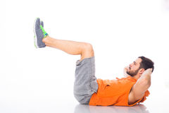 Young man doing exercises Royalty Free Stock Photo