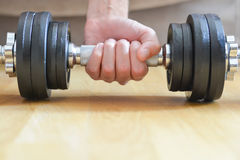 Young man doing exercises with dumbbells at home Royalty Free Stock Photos