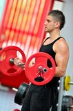 Young man doing exercises in the gym Royalty Free Stock Photography