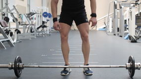 Young man doing exercises in a gym.  stock footage