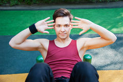 Young man doing fitness exercise Royalty Free Stock Photo