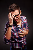 Young man doing a frustration gesture Stock Photo