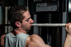 Young man doing heavy weight exercise for back Stock Photos