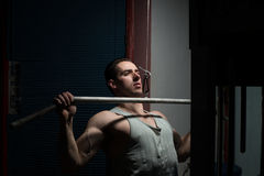 Young man doing heavy weight exercise for back Stock Photo