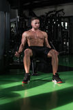 Young Man Doing Heavy Weight Exercise For Biceps Stock Photo