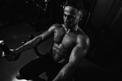 Young Man Doing Heavy Weight Exercise For Chest Stock Photo