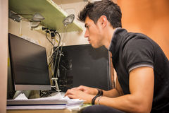 Young Man with Doing Homework at Computer Desk Stock Image