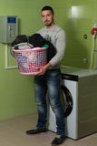 Young Man Doing Housework Laundry Royalty Free Stock Photos